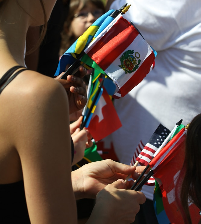 person holding flags from several countries