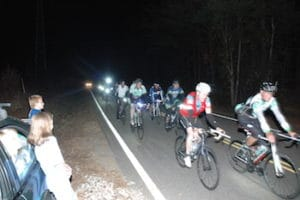 cyclists riding at night