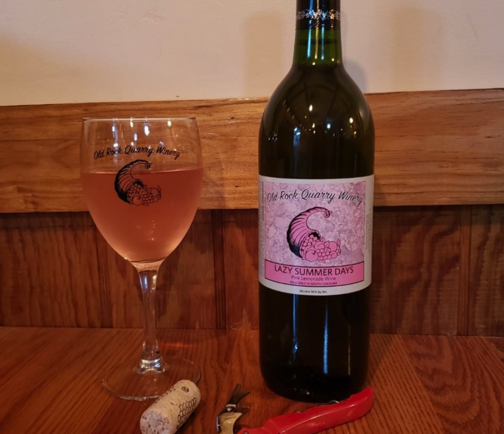 glass of wine next to a bottle of wine